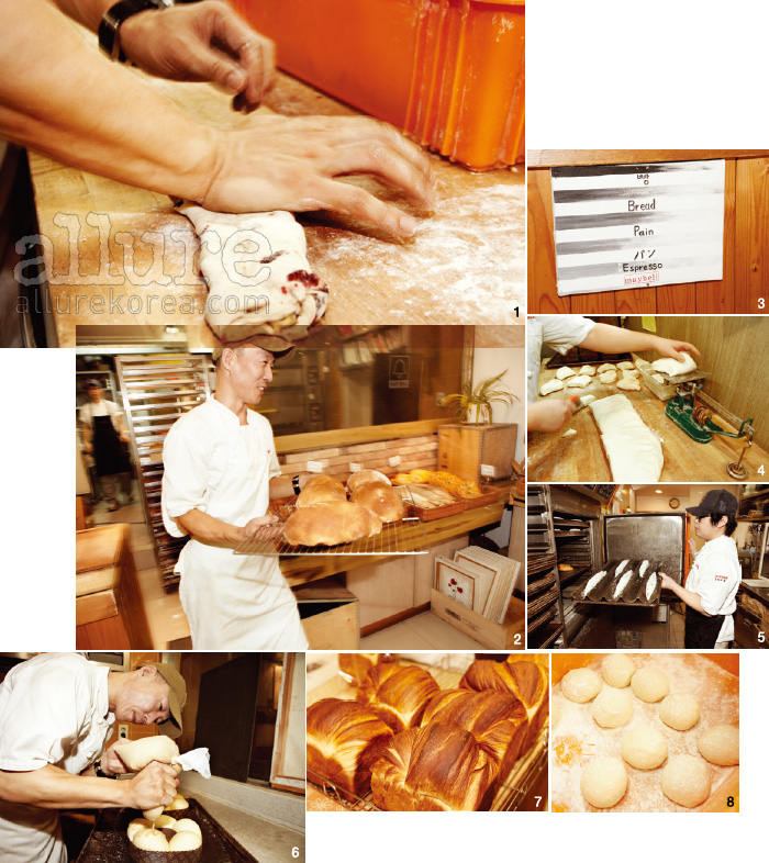 1, 6, 8.  베이커 정웅의 단단한 두 손에서 빵이 만들어지고 있다. 2.  매장에 빵을 진열하는 것도 그의 몫이다. 3.  매장 곳곳에서 만날 수 있는 그의 손글씨. 4.  10년도 넘은 저울을 여전히 애용한다. 5.  오븐으로 들어가는 바게트의 모습. 7.  멋부리지 않은 투박한 모양새의 빵은 주인을 닮았다.