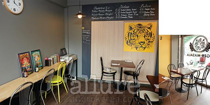 1 그래픽 디자이너의 감각이돋보이는 실내. 2 타이거마살라의 상징인 뱅골 호랑이.