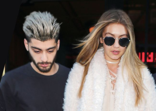 Gigi Hadid and Zayn Malik hold hands when coming out of their hotel in NYC