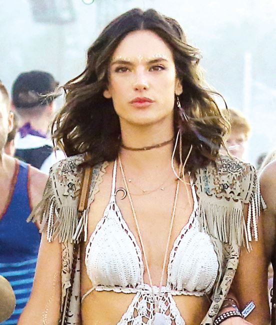 Alessandra Ambrosio was all smiles as she enjoyed the Coachella Arts & Music Festival in Indio, CA. The model was all seen dancing in the crowd and flashing the peace sign while walking with her model friends  Pictured: Alessandra Ambrosio Ref: SPL1266852  190416   Picture by: Sharpshooter Images / Splash  Splash News and Pictures Los Angeles:310-821-2666 New York:212-619-2666 London:870-934-2666 photodesk@splashnews.com