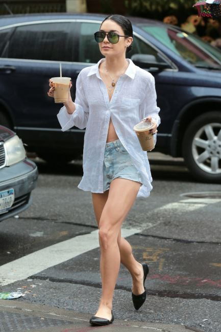 Vanessa Hudgens went to a coffee shop and got two cups before returning home in New York on June 28, 2015.  Pictured: Vanessa Hudgens Ref: SPL1062916  280615   Picture by: NIGNY / Splash News  Splash News and Pictures Los Angeles:	310-821-2666 New York:	212-619-2666 London:	870-934-2666 photodesk@splashnews.com