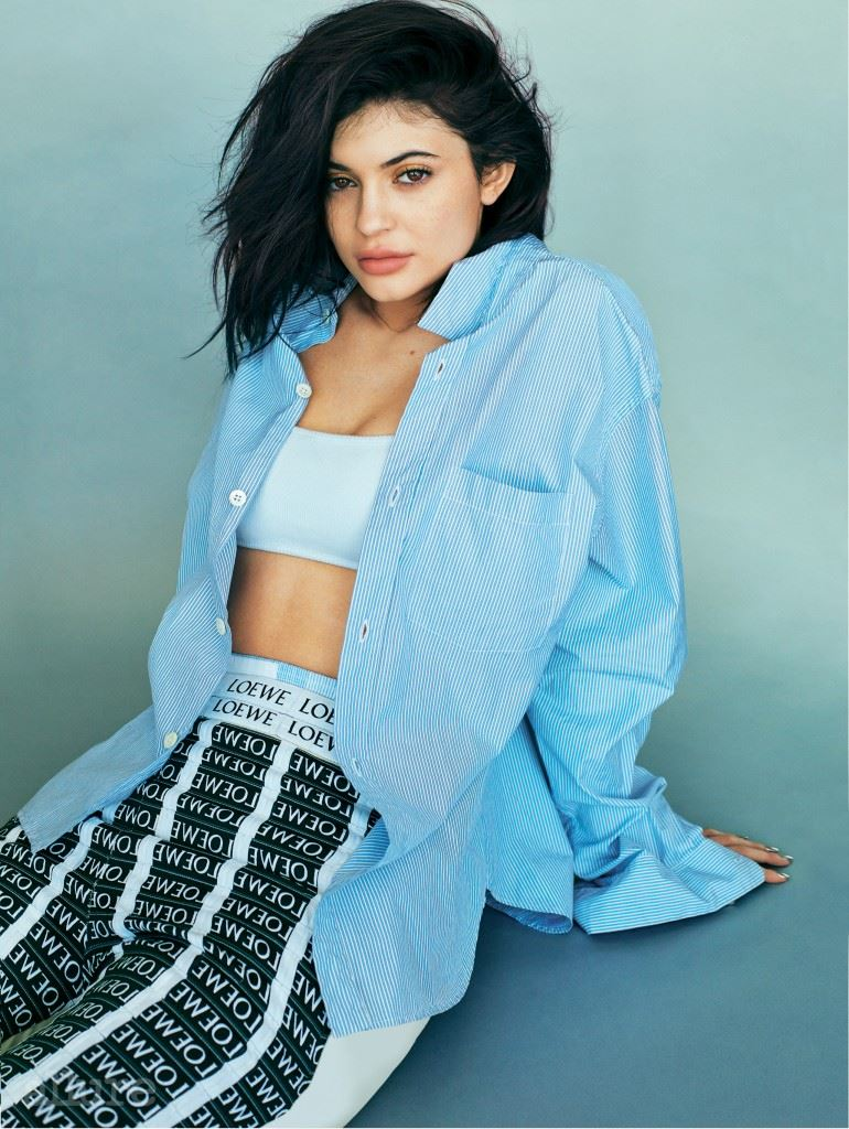 Cover feature, interview with Kylie Jenner, social issue, powerhouse, portrait, wears striped shirt, bandeau bra, Loewe trousers