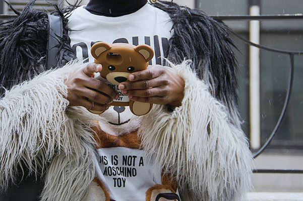 NEW YORK, NY - FEBRUARY 15: Niki Sha seen at Skylight at Moynihan Station outside the Jeremy Scott show wearing Moschino outfit with teddy bear phone case during New York Fashion Week: Women's Fall/Winter 2016 on February 15, 2016 in New York City.  (Photo by Georgie Wileman/Getty Images)