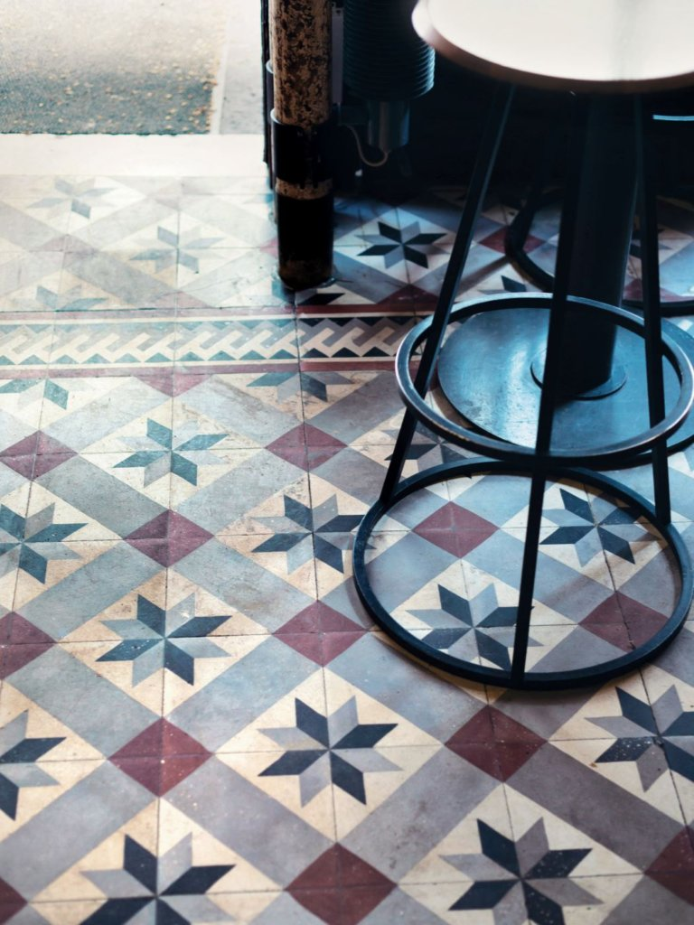 relates to feature, Little Mix, French food scene, cuisine, interiors of Clown Bar, tiled flooring, bar stool
