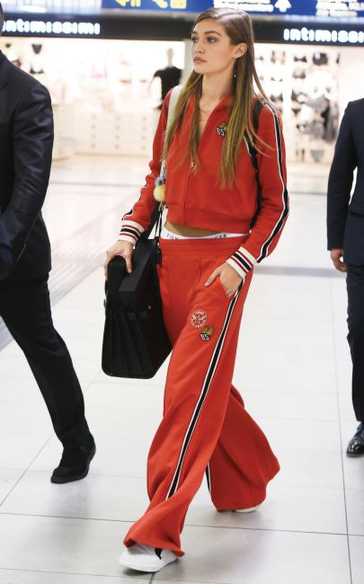 Gigi Hadid is seen escorted with 4 bodyguards after the attack in Milan during Milan Fashion Week in Milan, Italy  Pictured: Gigi Hadid Ref: SPL1361661  240916   Picture by: Splash News  Splash News and Pictures Los Angeles:	310-821-2666 New York:	212-619-2666 London:	870-934-2666 photodesk@splashnews.com