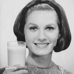 UNITED STATES - CIRCA 1950s:  Woman holding glass of milk.  (Photo by George Marks/Retrofile/Getty Images)
