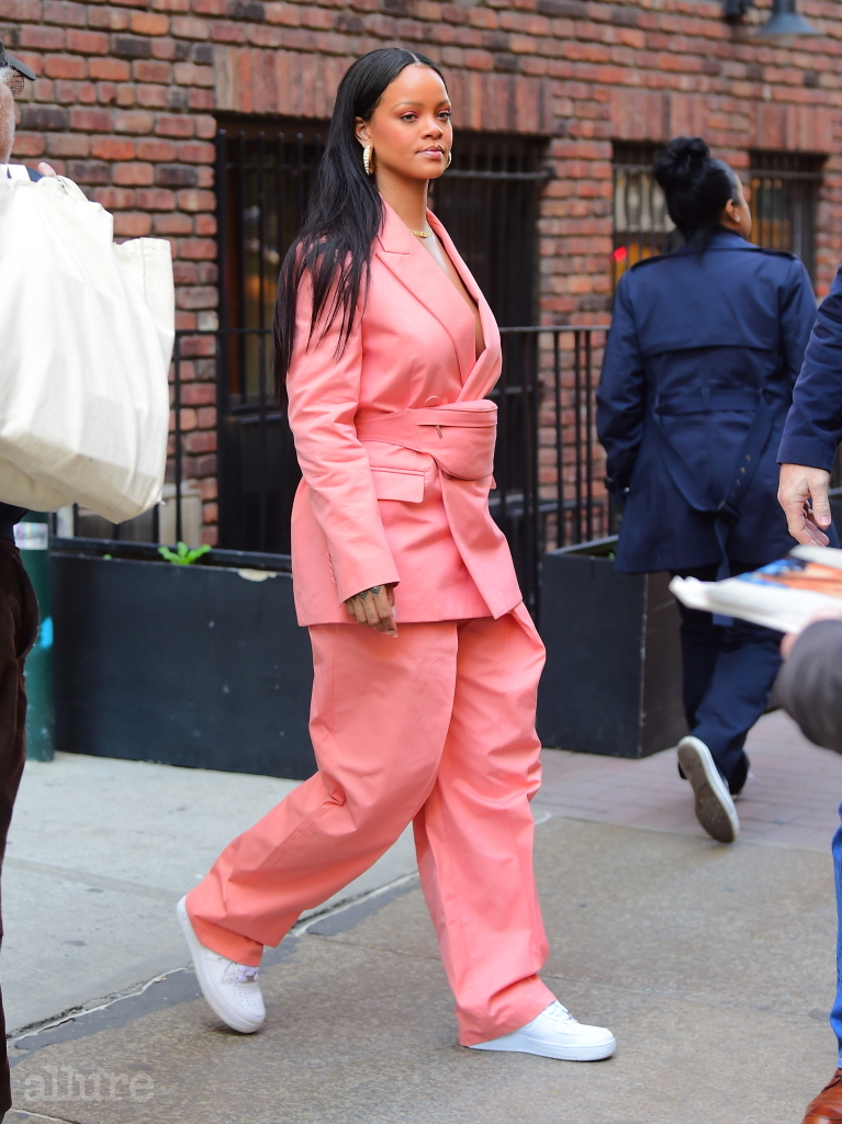 EXCLUSIVE: Rihanna Leaves Business Lunch Wearing Chic Oversized Coral Pant Suit . She looked amazing in a casual oversized pant suit with a matching fanny pack. She stopped to sign autographs for a fan before hopping into her SUV. Pictured: Rihanna Ref: SPL5080727 170419 EXCLUSIVE Picture by: DIGGZY / SplashNews.com Splash News and Pictures Los Angeles: 310-821-2666 New York: 212-619-2666 London: 0207 644 7656 Milan: 02 4399 8577 photodesk@splashnews.com World Rights, No Portugal Rights