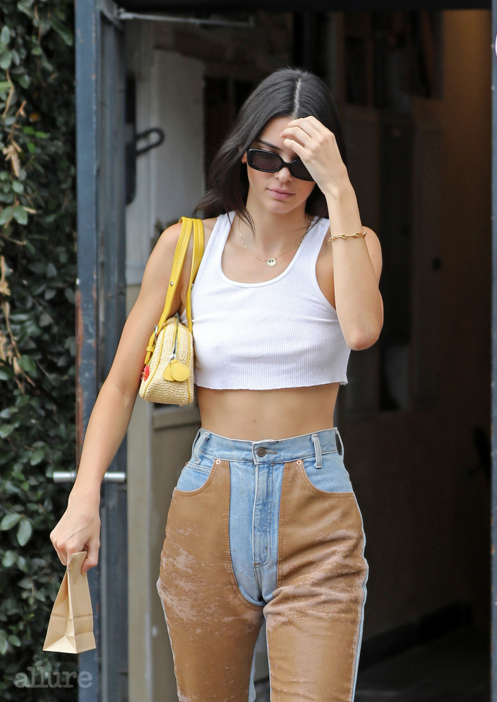 Kendall Jenner is camera-shy, wearing L.E.I mom jeans and Velvet Canyon sunglasses as she leaves Alfreds Coffee on Melrose Place in a white vest and riding chaps. Pictured: Kendall Jenner Ref: SPL5097307 110619 NON-EXCLUSIVE Picture by: SplashNews.com Splash News and Pictures Los Angeles: 310-821-2666 New York: 212-619-2666 London: 0207 644 7656 Milan: 02 4399 8577 photodesk@splashnews.com World Rights, No Brazil Rights